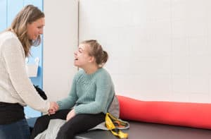 girl with intellectual disability smiling at carer